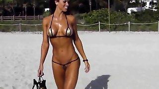 Far-out short bikini cameltoe string on beach