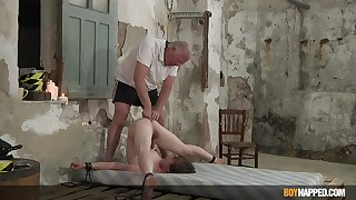 Slim twink endures old man's dirty castigation in serious anal BDSM play
