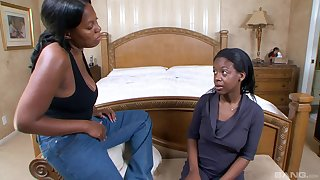 Ebony lesbians drop their garments to be thrilled by wide a large strapon